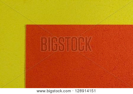 Eva foam ethylene vinyl acetate orange surface on lemon yellow sponge plush background