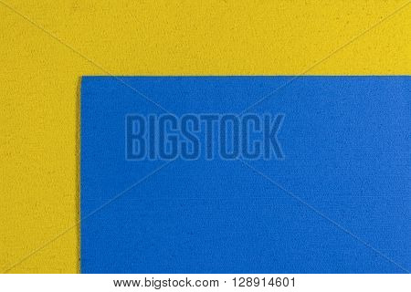 Eva foam ethylene vinyl acetate blue surface on lemon yellow sponge plush background