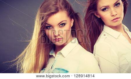 Two Beautiful Photomodels Portrait.