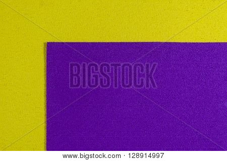 Eva foam ethylene vinyl acetate purple surface on lemon yellow sponge plush background