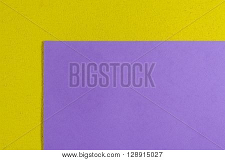 Eva foam ethylene vinyl acetate smooth light purple surface on lemon yellow sponge plush background