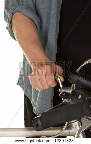 Man repairing bicycle handlebar over white background