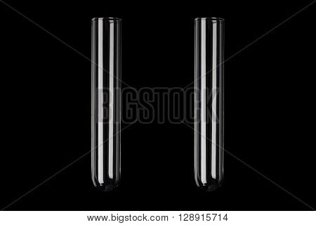 Two glass transparent test tubes on black background