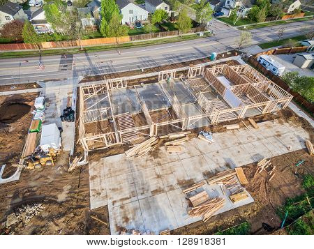 FORT COLLINS, CO, USA - May 8 2016: Aerial  view of building construction, lumber and machinery at Manhattan Ave in Fort Collins, Colorado