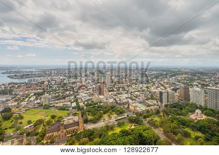 Sydney Australia - November 11 2014: Aerial view of Sydney from Sydney Tower in cloudy weather Sydney New South Wales Australia. Hyde Park in the foreground.