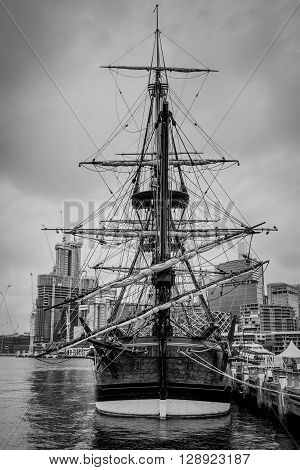 Sydney Australia - November 11 2014: View of the replica of captain Cooks sailing ship HM Bark Endeavour on a cloudy day black and white photography Sydney New South Wales Australia. HM Bark Endeavour Replica is a replica of HMS Endeavour the bark command
