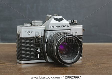 BUDAPEST, HUNGARY - MAY 1, 2016: Praktica PLC3 film SLR camera with Carl Zeiss lens. Prakticas were popular cameras build in Eastern Germany