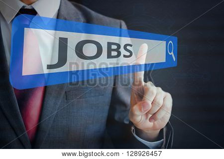Businessman tapping and searching JOBS on search bar
