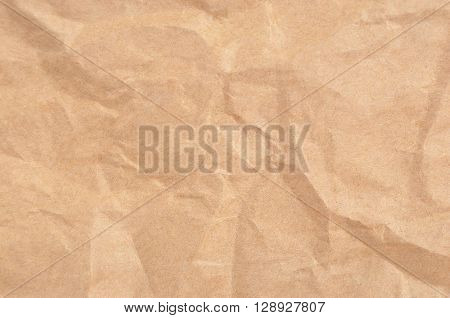 Wrinkled packaging paper background close up DOF
