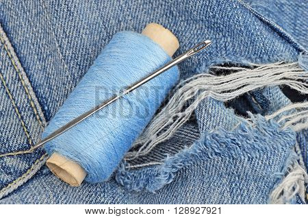 Threads On Jeans, Wear Repair Concept