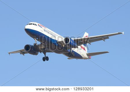 SAINT PETERSBURG, RUSSIA - MARCH 20, 2016: Airbus A320-232 (G-EUYM) British Airways on a background of blue sky