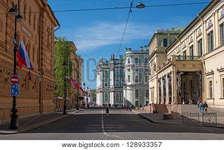 St. Petersburg Russia - May 8 2016: view of the Hermitage -Winter Palace- the New Hermitage and sculptures of Atlantis. Tourists visiting the sights on a sunny day.