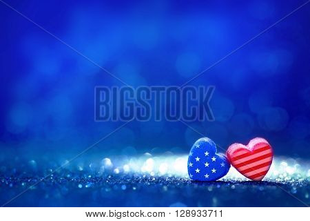 The American flag Heart shapes on abstract light glitter background concept for 4th July Independence day