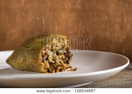 Pepper stuffed with meat and bulgur on white plate