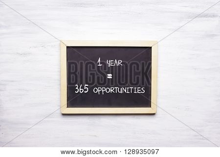 Top View Of Chalkboard With 1 Year, 365 Opportunities Written On