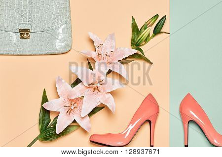 Glamor luxury shoes heels, stylish handbag clutch, summer lily flowers. Fashion woman accessories set.  Elegant girl. Unusual creative look. Overhead, romantic. Top view, vanilla pastel background