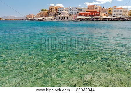 The old Venetian harbor and the Mosque Hassan Kuchuk Pasha in Chania. Crete.