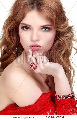 A beautiful young whiteheaded woman is in red clothes, isolated on a white background