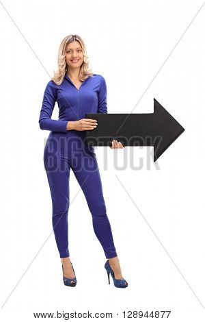 Full length portrait of a young woman holding an arrow isolated on white background