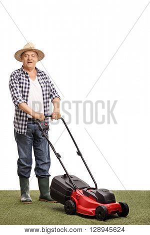 Full length portrait of a mature man posing with a lawnmower isolated on white background