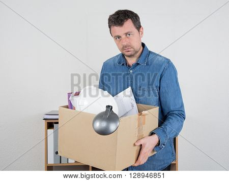 Desperate Businessman Carrying His Staff In Box