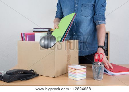 Man Unrecognizable Preparing The Box Beacause He Is Fired