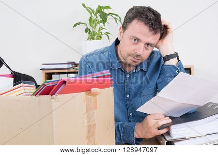 Sad Man Reading A Dismiss Notification, Preparing His Box