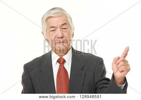 senior Japanese businessman doubting on white background
