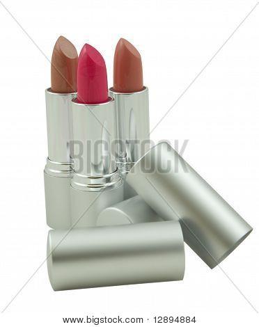 Three Lipsticks Over White Background