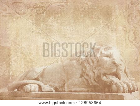 Sculpture of sleeping lion on grunge background with carved architectural details on stone as decoration on a facade building. Statue of lion in Lviv Ukraine.