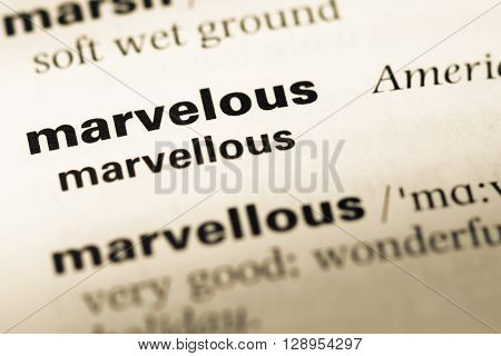 Close Up Of Old English Dictionary Page With Word Marvelous.