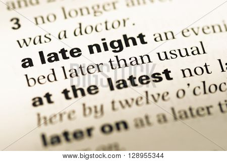 Close Up Of Old English Dictionary Page With Word A Late Night.