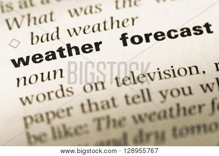 Close Up Of Old English Dictionary Page With Word Weather Forecast.