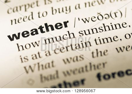 Close Up Of Old English Dictionary Page With Word Weather.