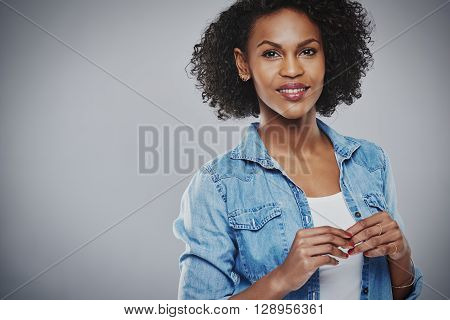 Smiling Woman In Blue Holds Hands Together
