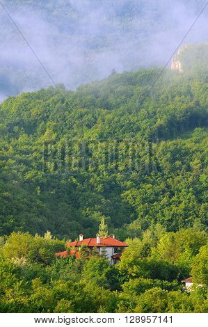 VETRINTSI VILLAGE, VELIKO TARNOVO PROVINCE, BULGARIA - MAY 8, 2016: Foggy morning in the mountain village