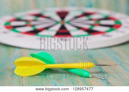 yellow and green dart arrow on dartboard