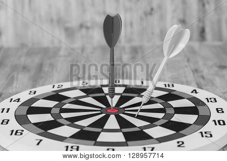 black and whitte tone ,Dart hit the center of dartboard
