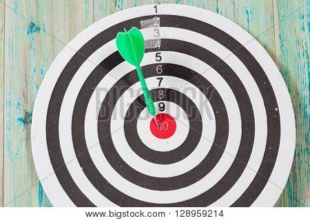 green  Dart hit the center of dartboard