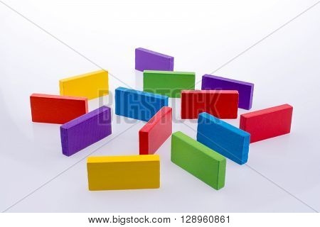 Some color dominoes on a white background