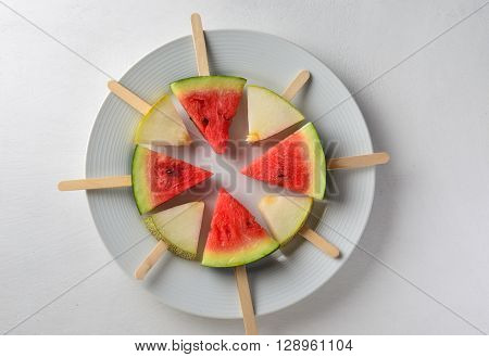 Popsicles of sweet melon and watermelon. Healthy and fun substitute to sugary food for kids.