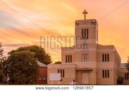 St Marys Anglican church in Levin built very strong looking with a wonderful sunrise behind it.