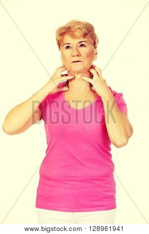 Senior woman with throat ache