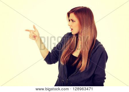 Teenage woman threatens someone the finger