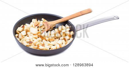 Croutons in a frying pan on a white background