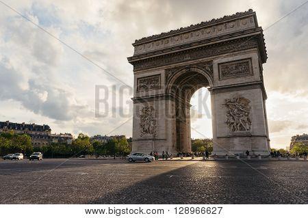 Triumphal arch view in Paris city at sunset. Arc de Triomphe, paris, France.