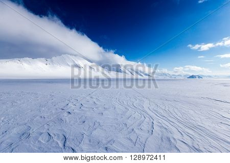 Arctic desert on top of a glacier on the Spitsbergen island