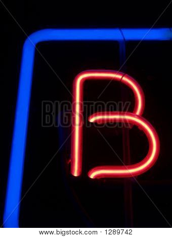 "Neon Red ""B"" With Blue Frame"