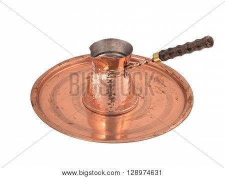 Old copper coffee pot isolated on white