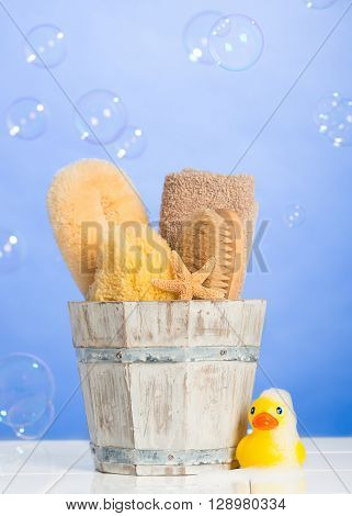 Spa items on fresh blue background with floating bubbles